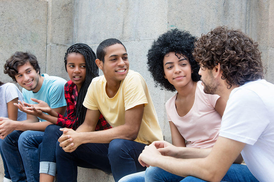 youth talking and smiling